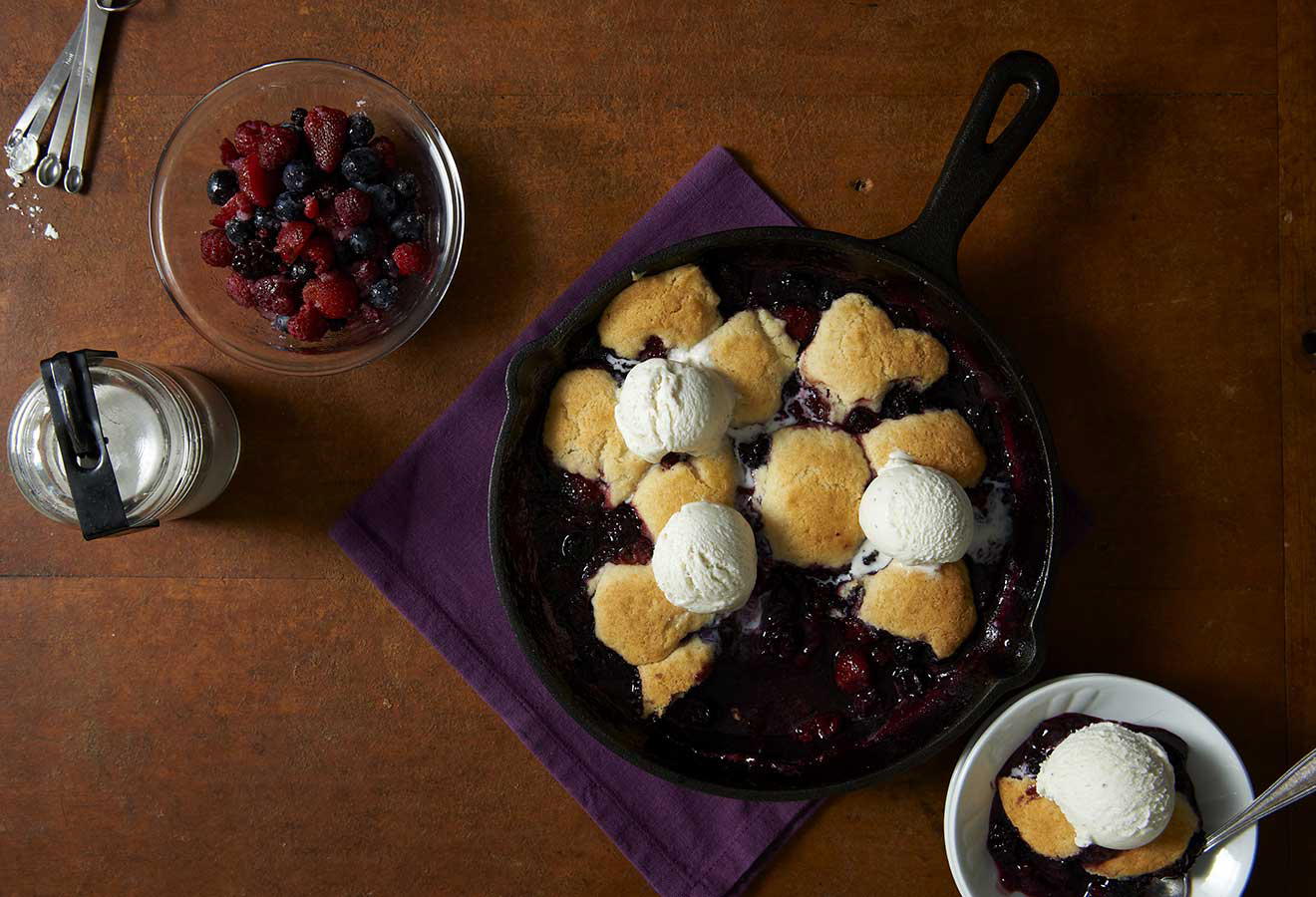 Vanilla ice cream and berry cobbler